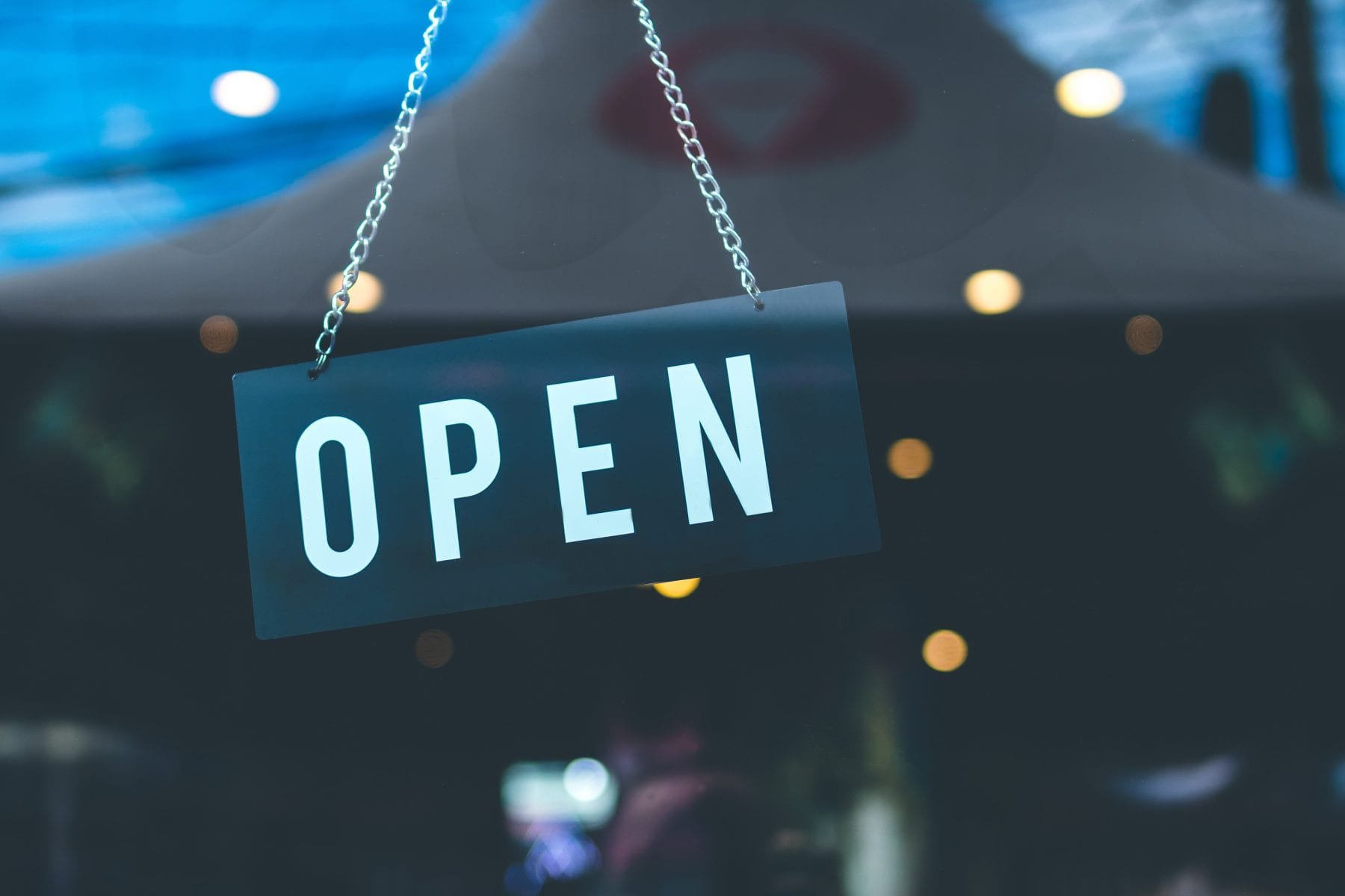 """Photo :sign hanging, reads """"open"""""""
