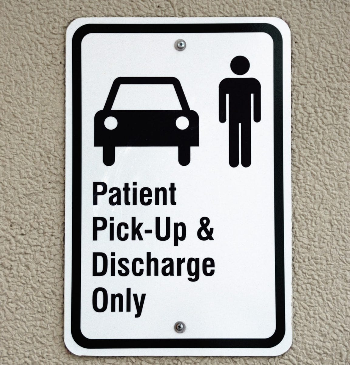 sign says patient pick up and discharge only